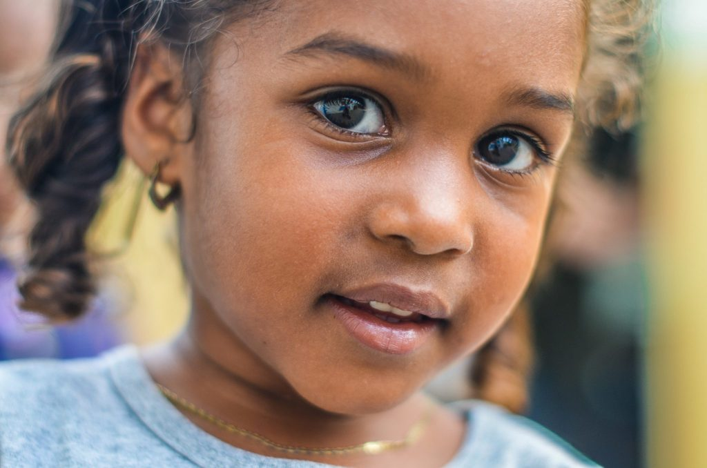 African American young girl looking at camera