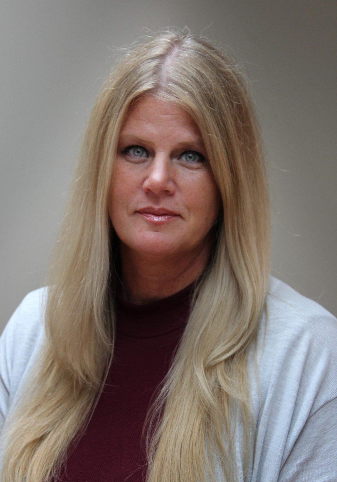 Kim Scorza, Executive Director
